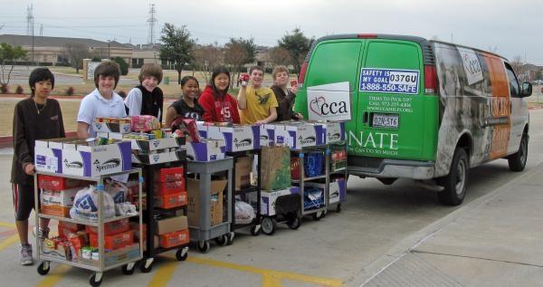 Creek Valley Students help load the CCA van