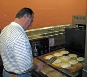 Alleluia! men\'s group members cook at our Souper Bowl Pancake Breakfast.