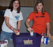 Two of the Acteens at Community Baptist Church in Greensburg, KY load up the cans the group collected.