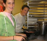 MPC Youth Preparing food for shelter.
