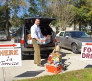 Brent Brown, Managing Partner, Brownstone Developers Loads Donated Pantry Items for Delivery to Mandarin Food Bank