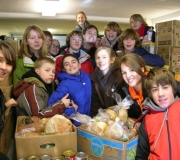 St. Matthew UCC youth serving at the People\'s Resource Center in Wheaton, IL