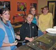 Alleluia! Girls serving pancakes during our annual Souper Bowl Free Pancake Breakfast.