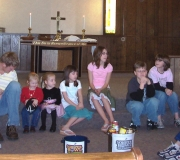 NUMY leading the Souper Bowl of Caring children\'s sermon.